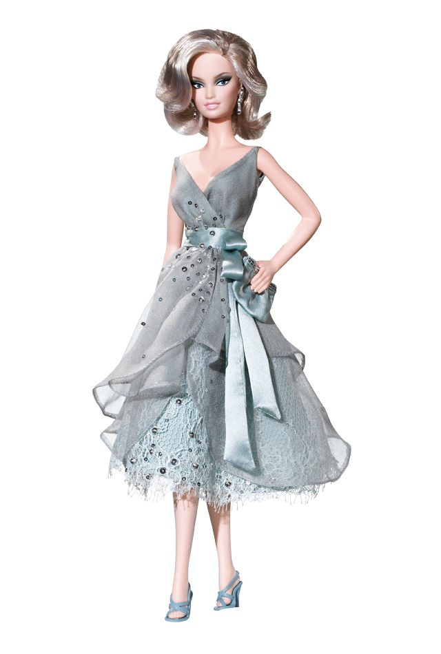 Splash of Silver™ Barbie® doll celebrates the wondrous urbanity of city living! Dressed for an evening out on the town, the doll wears an alluring dress of chiffon and lace. Inspired by the silvery blue-grey hues of modern urban life, the dress features a scattering of brilliant, silvery crystals.
