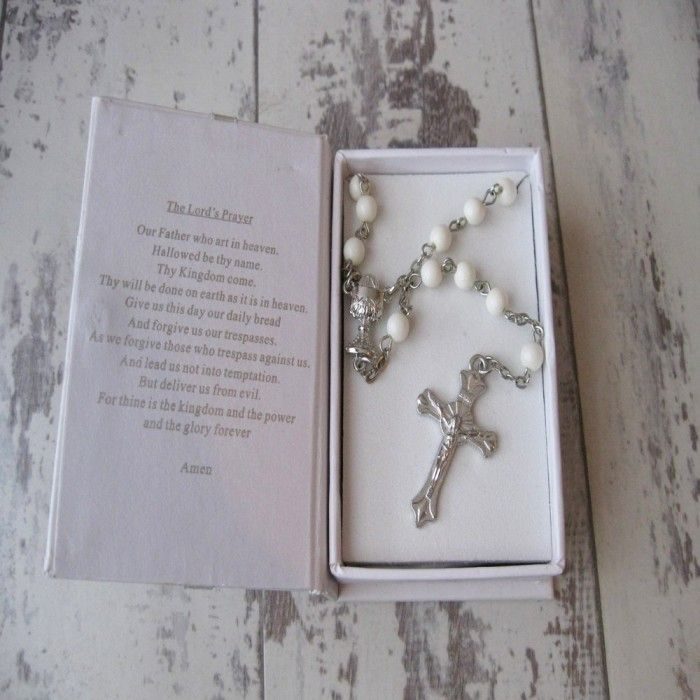 These are beautiful First Holy Communion rosary beads in a Bible presentation box. The beads have a Chalice Goblet detail and cross. www.graangels.ie