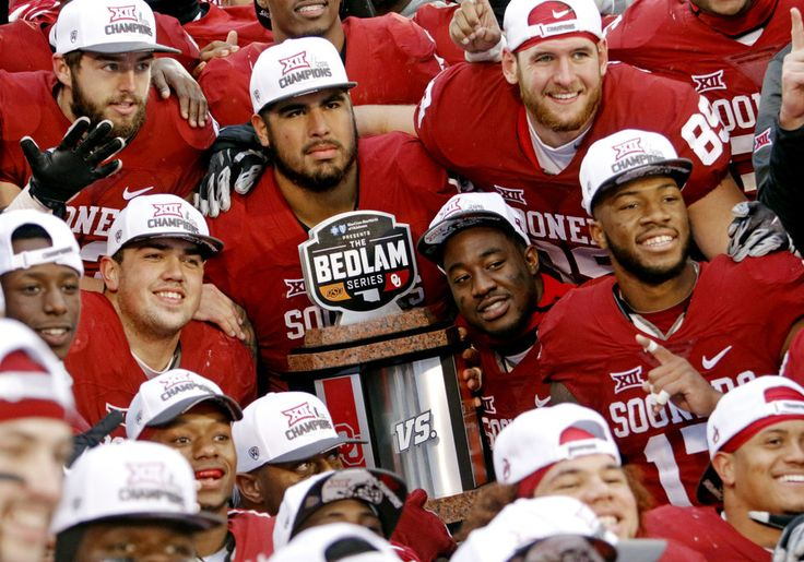 Players display the Bedlam trophy following the Bedlam college football game between the Oklahoma Sooners (OU) and the Oklahoma State Cowboys (OSU) at Gaylord Family - Oklahoma Memorial Stadium in Norman, Okla., Saturday, Dec. 3, 2016. Photo by Steve Sisney, The Oklahoman