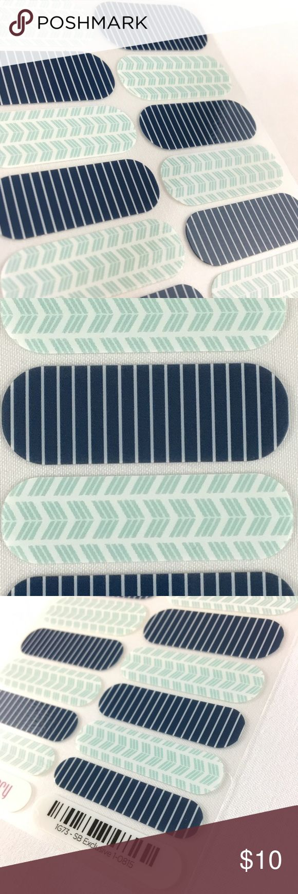 "Jamberry Marina Nail Wraps, SBE, Full Sheet These two designs are great for summer! One navy blue with white pinstripes, the other white with light turquoise arrows in something of a chevron pattern. Both designs are sure to delight!  This Full Sheet includes 18 Nail Wraps; each piece is designed to be used on two nails! Wear them all or as accents, on natural or acrylic nails—lasts up to 2 weeks!  Titled ""SB Exclusive 1-0815"" and numbered 1G73.  This item was an August 2015 StyleBox…"