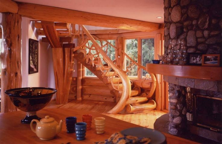 Curving log stair in a post and beam home in British Columbia.  For more photos or this or any other or my homes, please check out my website, www.designma.com, my Design Page, www.facebook.com/loghomedesign, or Pinterest, http://www.pinterest.com/murrayarnott/murray-arnott-design  #logstair #postandbeam #spiralstair #loghomesforsale