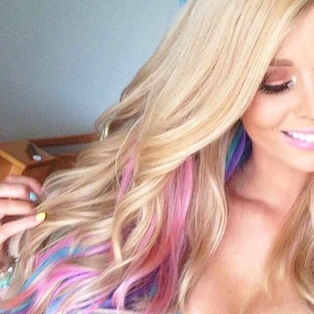 Blonde hair with colors underneath.