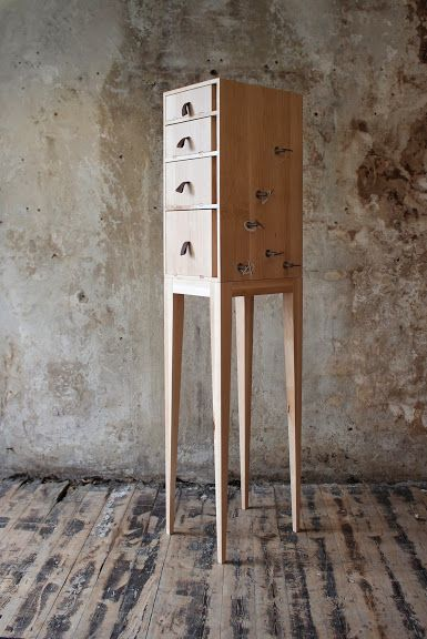 """""""The Domestichorpophone"""" is a cabinet with the features of a musical instrument. The handcrafted maple wood combined with walnut and metal details is a reference to the classical appearance of a string instrument. When the user pushes or pulls a single drawer, sound is produced. The user can personalize sound by tuning the strings that every drawer produces different chord. In this way the user can find his or her own means of sound within the personal space."""