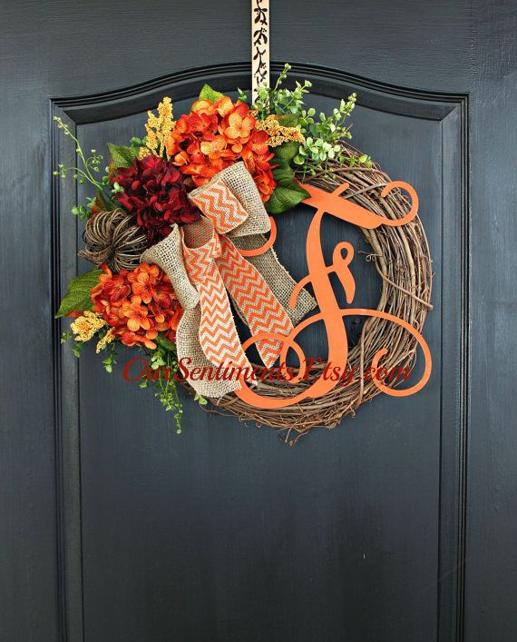Large Fall hydrangeas, foliage and a double bow combined with a festive rustic pumpkin, this wreath is perfect to celebrate the Autumn season.