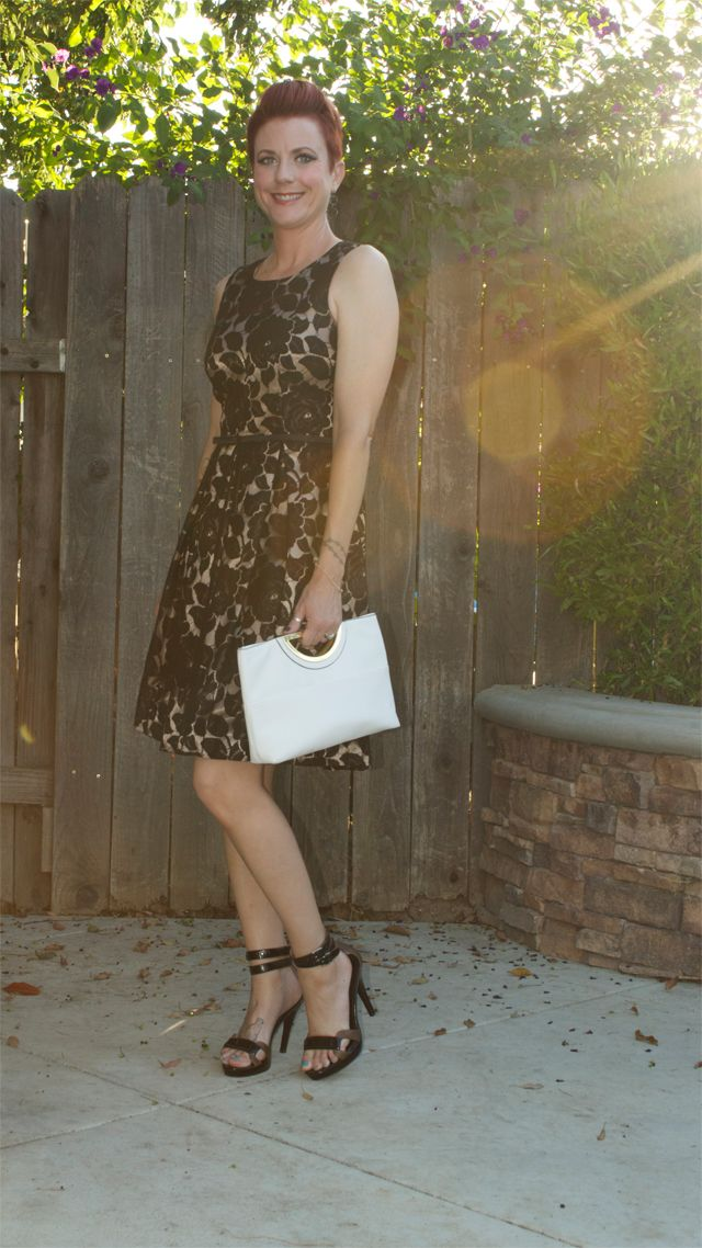 Lace dress, strappy heels and a white clutch for girls night out.