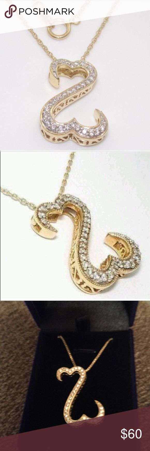 """OPEN HEART PENDANT SND CHSIN NEW OPEN HEART PENDANT AND BOX CHAIN AAAA CLEAR. CZ MEASURES APPROX 2"""" 14K YELLOW GOLD PLATING OVER STAINLESS STEEL ADJUSTABLE BOX CHAIN IS APPROX 16-20"""" includes velvet gift box Jewelry Necklaces"""