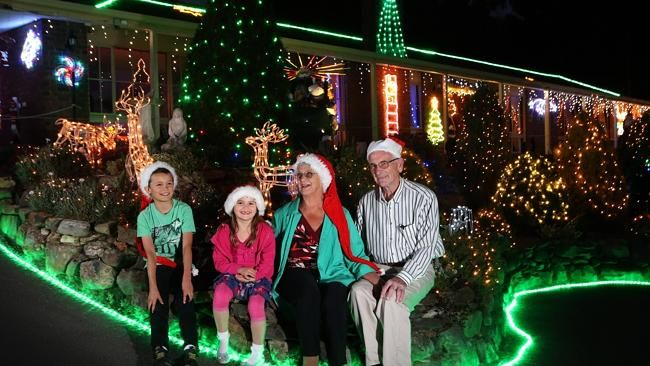 SWITCHING ON: Bill and Peg Chartres live on Christmas Lane and have a huge Christmas ligh