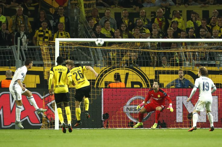 Real Madrid's Portuguese forward Cristiano Ronaldo reacts after scoring a goal that was disallowed past Dortmund's Swiss goalkeeper Roman Buerki during the UEFA Champions League first leg football match between Borussia Dortmund and Real Madrid at BVB stadium in Dortmund, on September 27, 2016.