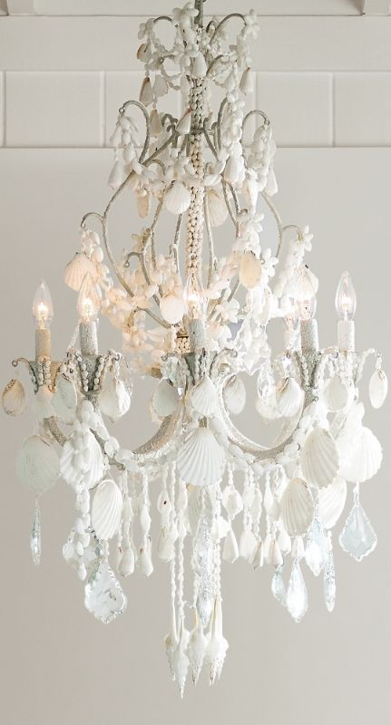An ethereal symphony of cascading crystals and seashells, our Harbor Shell Chandelier casts a captivating note in any space.  | Frontgate Interiors