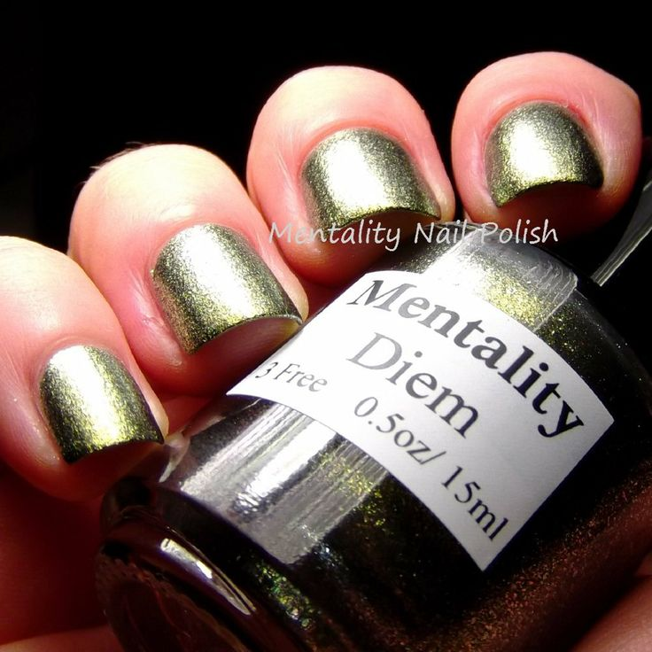 Mentality Nail Polish - Diem is a blackened color shifting fleck polish. Straight on, Diem is a yellow green, then shifts to green and silvery white, depending on the light angle. Dries to a glossy finish.
