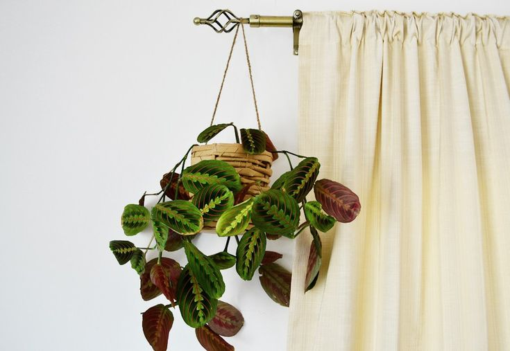 Recycle your IKEA paper bags to make this beautiful woven paper planter by following some easy steps