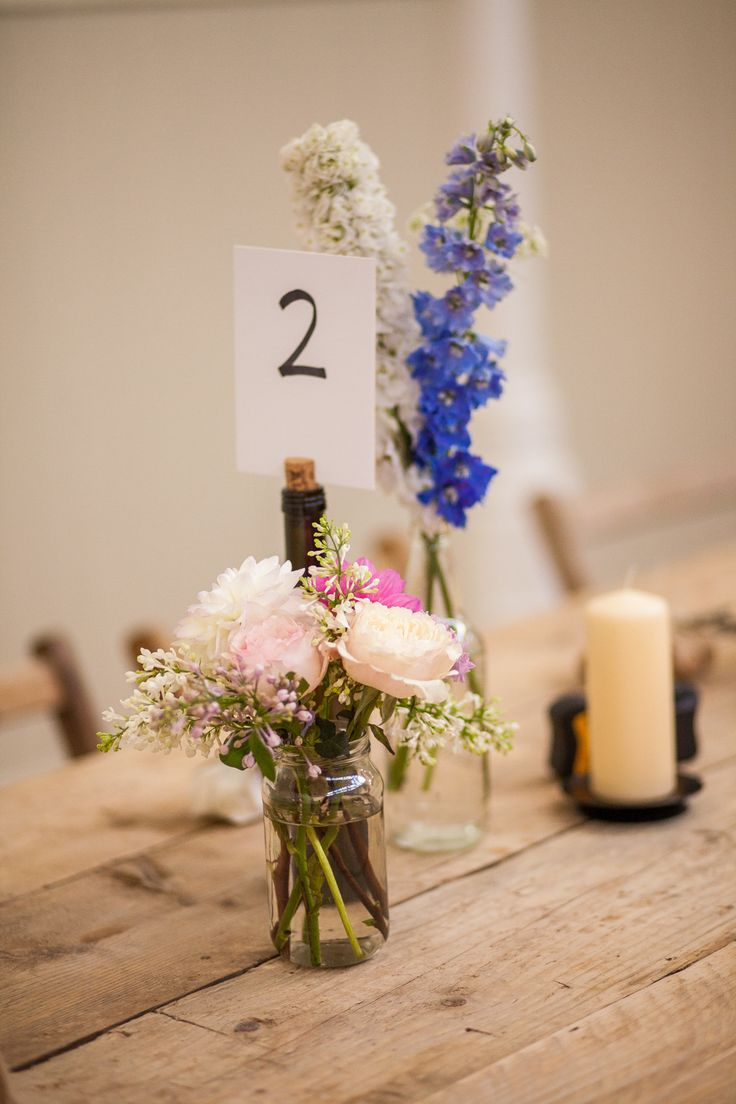 Wild Flower Table Decor and Church Candles | http://www.rockmywedding.co.uk/tammy-tom/ | Image by Sara Dalrymple Photography