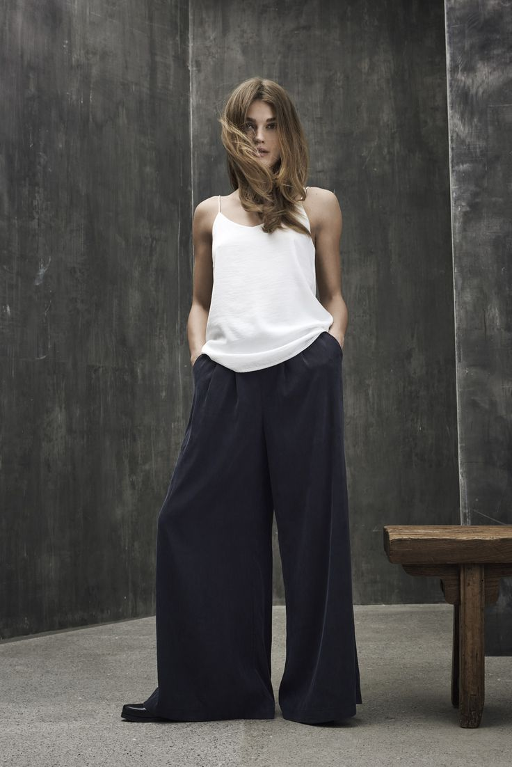 Big flaired trousers with a simple white top.