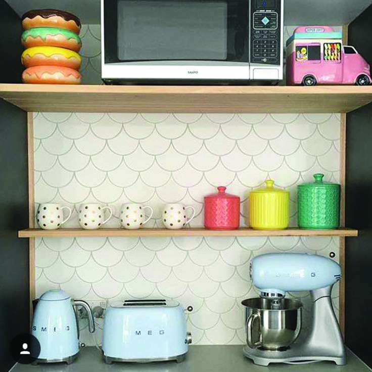 Spanish feature tiles look delightful in this cute kitchen!   Regram from @prettyparcel  #tilestyle