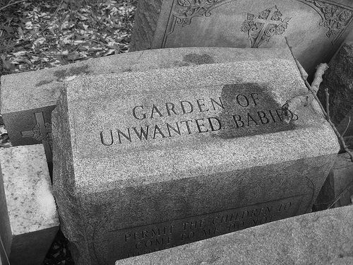 "This one kind of shocked me a bit. Is it a memorial or a mass grave? I would guess that it is a ""pauper's"" gravesite for orphaned/abandoned children..."