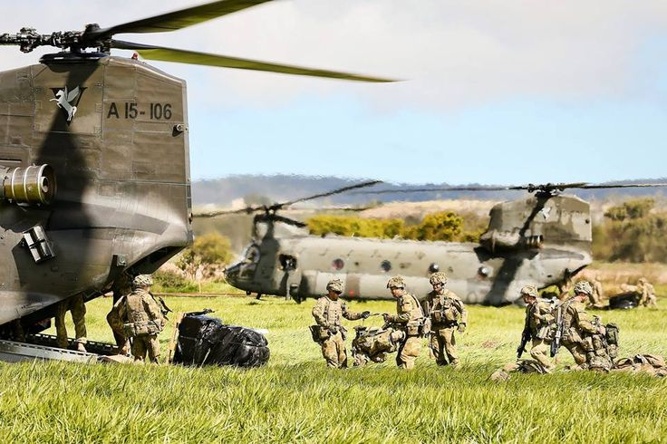 Soldiers from 3 RAR dismount from 5th Aviation Regiment CH-47 Chinooks during Exercise Hamel 2014 at the Tolga Turf Club near Atherton on July 13. Photographer: Corporal Mark Doran
