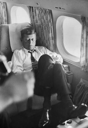 On his private plane during the 1960 election campaign