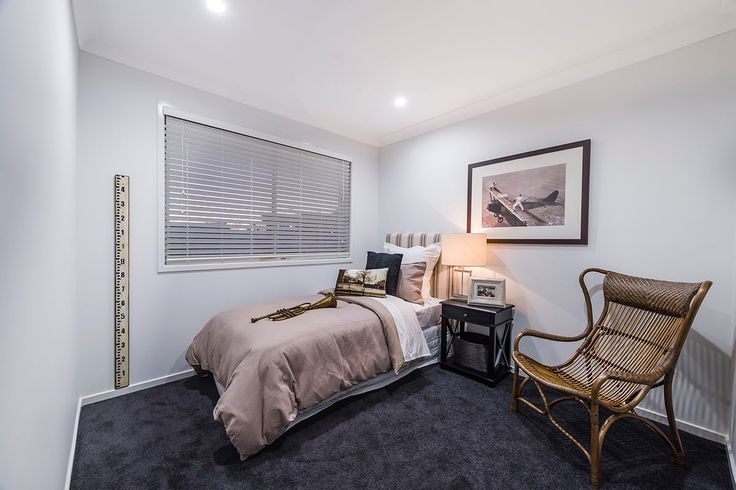 #Bedroom #interior #design #inspiration from #Ausbuild's Ellison display home. This #bedroom features soft grey carpet combined with crisp white walls and a striped #bed head. This room also #features a #vintage rattan #chair.