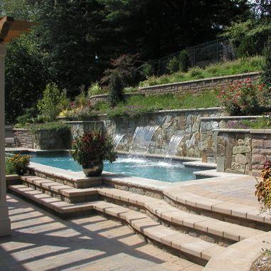 Hillside pool terraced retaining walls lighting for Pool design austin