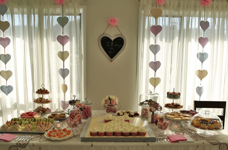 What a beautiful spread for a lovely bridal shower. Chalkboard with a countdown to the wedding was a fun touch.