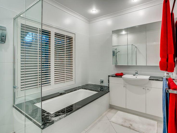 5 Rees Way, Brookfield // Mario Sultana #bathroom #bathroominspiration #homeinspiration #neutral #tiles #sink #home #homedecor #brisbane #queensland #realestate #inspiration #homedecorate #realestate #realtor #brisbanerealestate #decorator #interiordesign #modern #crisp #light #open #space