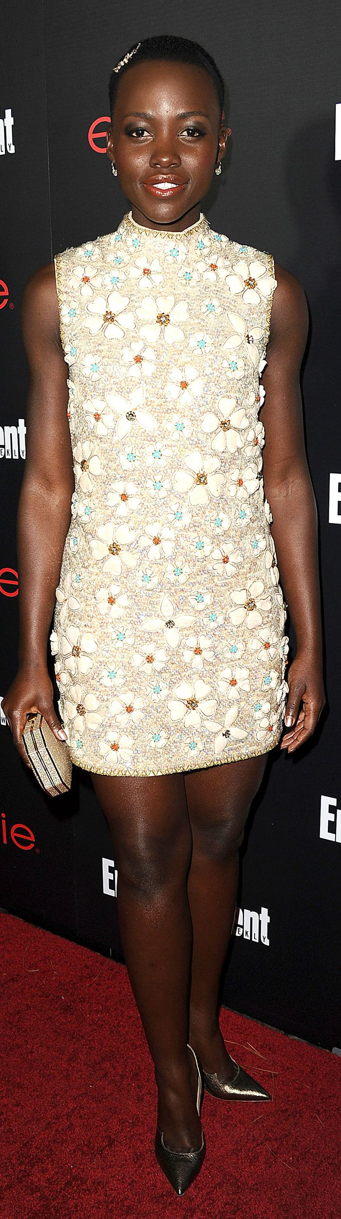 Lupita Nyong'o looked ever the style star that she is in an embroidered floral high-neck shift that she paired with metallic extras.