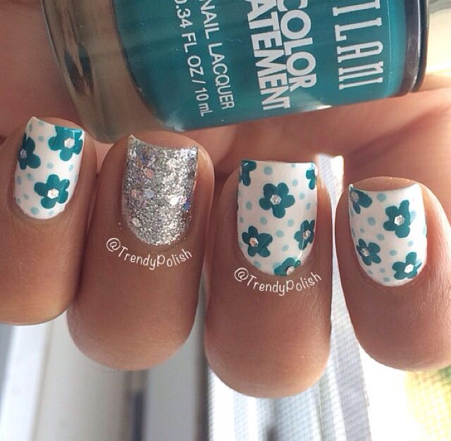 White with teal flowers, and silver chunky glitter accent nail: I would use this design, but with different colors, because I don't really like white nails.