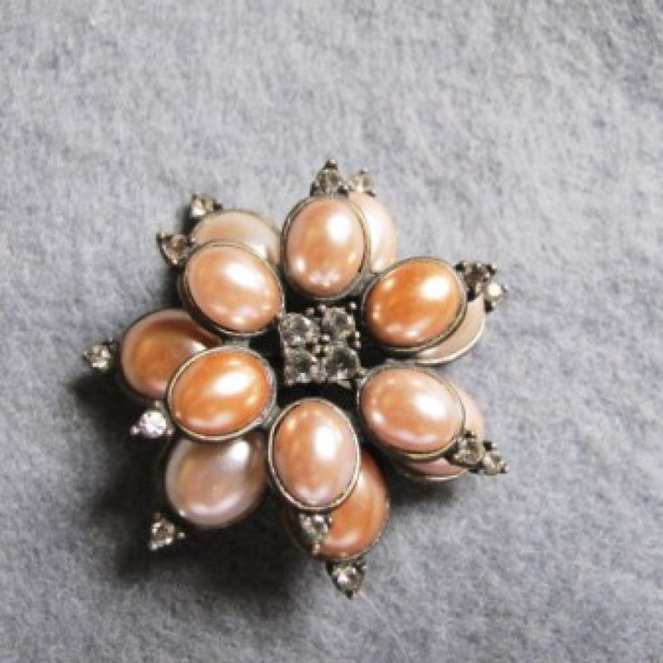 Faux pearl brooch Vintage on Velvet Rose's Pin Up Dressing Room  Faux pearl brooch vintage 1950's soft pink, tones set into an antique tone metal, smaller crystal chaton set of the faux pearls as well as in the centre of the brooch