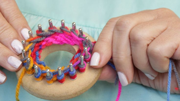 If you're having trouble with knitting needles, or just want to learn a new knitting technique, a round knitting loom is a very easy way to make a knitted hat. Give it a try! Click any photo to enlarge it. Make a slip knot. Tie the knot...