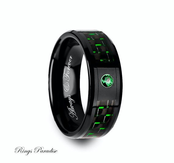 High Quality in Style Women's and Men's Ceramic Rings   Personalized Black Ceramic Ring with Black and Green Carbon Fiber and Green Emerald Setting - 8mm  Specification Carbide Wedding Bands *FINISH POLISHED *THICKNESS 2.0 MM - 2.2 MM *WEIGHT 6 - 13,5 GRAMS * COMFORT FIT AND SIZING *SIZES AVAILABLE 6-14 US INCLUDING 1/2 SIZES *DURABLE *HYPOALLERGENIC, COBALT - FREE *ITEM NUMBER 3904   Engraving: If you want your personal note to be engraved on the ring you are ordering, please let me know…