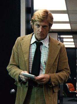"""Robert Redford in the """"Harried, Gruff, and Handsome"""" tan suit."""
