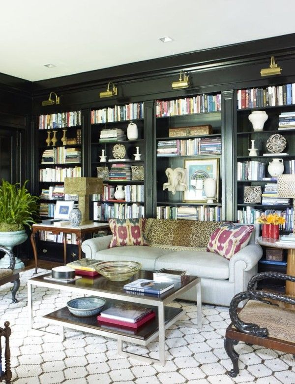 So many details to love...use of art lights, layers of items on shelves, bright pops of color & fresh patterns with traditional furniture, patterns on patterns, unusual combinations of tables & shapes, square recessed lights...bunny williams library