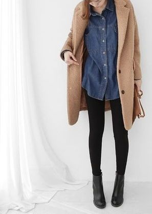 A very cute outfit with the denim button down shirt, the black leggings with the black combat boots, and the nude colored coat.