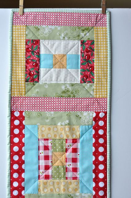 Courthouse Steps Table Runner for Pleasant Home Sew Scraps Along- I would totally make this if my scraps were that cute!