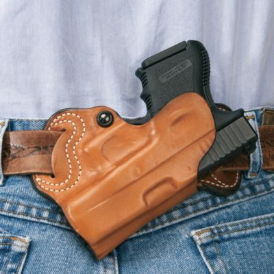 """The S.O.B. (Small of Back) secures your handgun in one of the most discreet carry positions. Unlined leather construction with 1-3/4"""" belt slots and tension device for a secure fit.  Available:  S.O.B. Glock 17/23/36, S.O.B. Glock 26/27, S.O.B. Small Revolver, S.O.B. 1911, S.O.B. Springfield XD."""