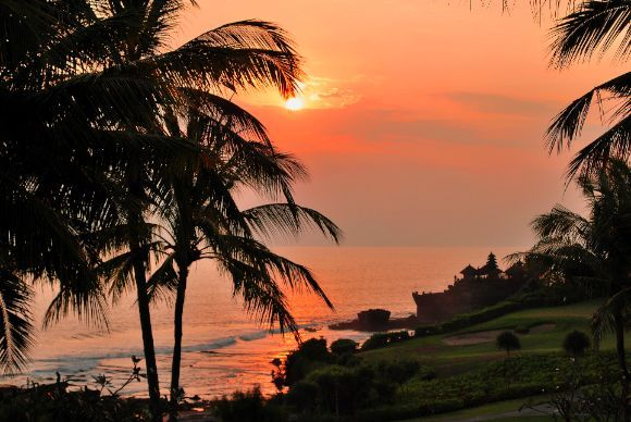 A beautiful sunset over the historic Tanah Lot, Bali. Snakes are said to guard this magical temple from evil spirits & harm. Book your dream Balinese break online now at www.dreamdestination-holidays.com for great prices in Bali & worldwide! Holidays, travel, vacation, honeymoon, adventure, Indonesia, Asia