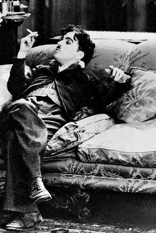 Charlie Chaplin as his classic character the tramp. <3 and smiles!
