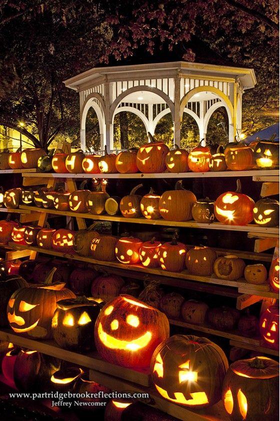 Keene Pumpkin Festival - As darkness falls, the lit jack-o-lanterns cast a warm glow in Keene's square.