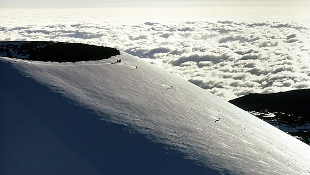 Yes, skiing. In Hawaii. Mauna Kea, a 13,796 foot, dormant volcano on the Big Island gets snow all winter long — enough to shred all day, and follow up with a surf, 60 miles away.