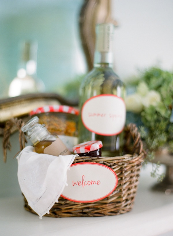Welcome baskets with wine, jam, etc. Photography by jenfariello.com, Floral Design by patsfloraldesigns.com