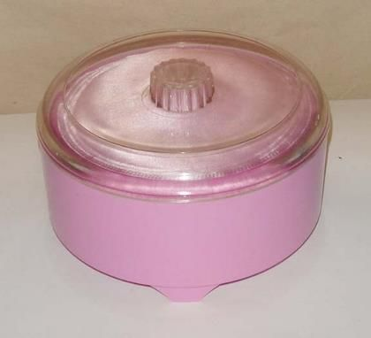 Everyone had the powder puff containers. When it was finished, it became a candy jar or junk container.