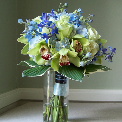 Blue & green bouquet from: bestdestinationwedding.com