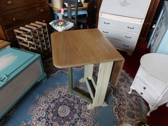 Lovely drop leaf table with slightly distressed painted legs, the top has been hand sanded back to bare wood with a waxed finish. ---------------- £65
