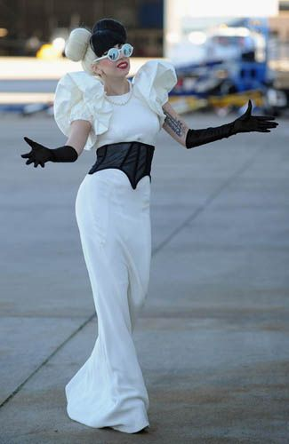This is kind of cute, minus the huge shoulders. Lady Gaga's 40 Wildest Fashion Ensembles~I like the shoulders, pssh