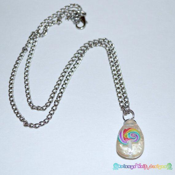 Polymer lollipop encased in resin https://www.etsy.com/listing/195321096/lollipop-in-resin-necklace-polymer