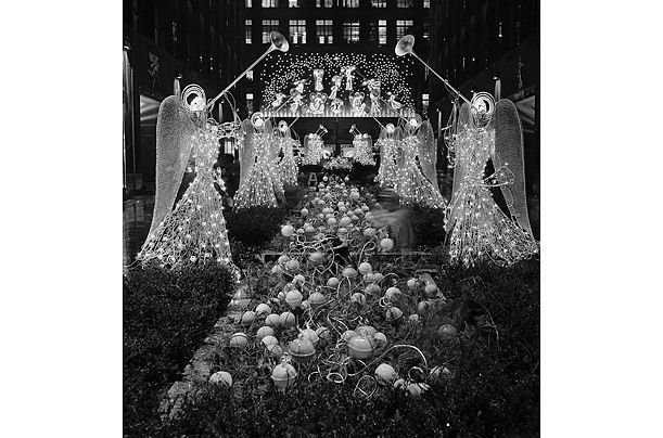 The tree's decorations have come a long way since 1931, when tin cans and scrap paper replaced garlands and glass. In 1934, organizers festooned that year's evergreen with 1,200 colored lights and ornaments shaped like dogs, horses, giraffes, sailboats and stars. A public-address system also piped in holiday tunes, creating the effect of a singing tree. The 1950s saw a white spray-painted tree, the return of garlands made of cranberries and popcorn....