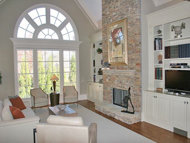 Stacked stone fireplace, vaulted ceiling, built in book ...
