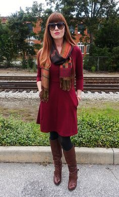 Wine-colored dress, patterned fall scarf, tights, brown boots.