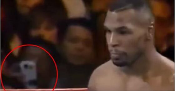 Conspiracy Theorists Go Crazy Over Smart Phone Spotted in 1995 Mike Tyson Fight Footage