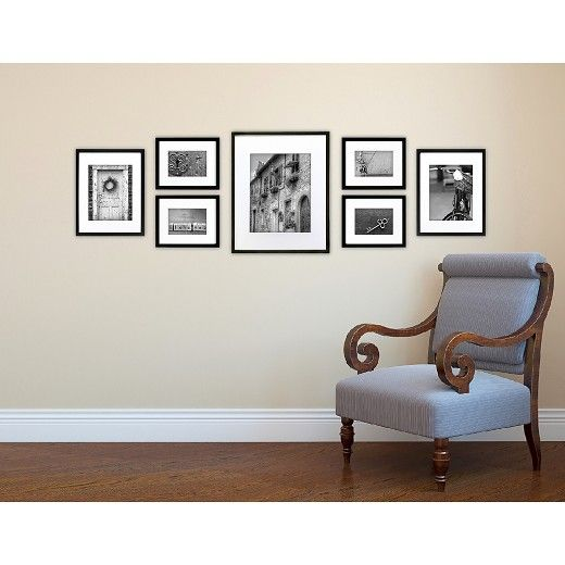 Display your most cherished photos with this  Gallery Perfect 7pc black gallery perfect Frame. This perfect wall frame includes a Three flexible hanging template options  7-Piece wood frame set for up to a 5-foot space With this versatile frame you can display on the wall Horizontally or Vertically.  A great addition to any room.